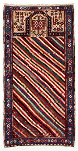 Sale 9130S - Lot 15 - An antique Caucasian Shirvan hand woven and vegetable dyed woollen prayer rug with blue floral border, crest & striped central design..