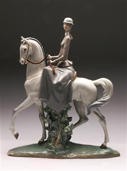 Sale 9122 - Lot 12 - Lladro Figure of a Woman on Horseback (H:44cm L:36cm)