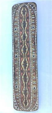 Sale 8600A - Lot 44 - A Papua New Guinean Sepik River wooden war shield, H 197 x W 48cm.
