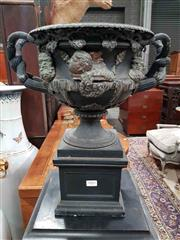 Sale 8939 - Lot 1001 - Cast Metal  Copy of the Warwick Vase, of campagna form, with relief busts & entwined branch handles, on square socle H: 41, D: 27cm