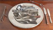 Sale 8470H - Lot 77 - A circular stainless steel party tray and contents including various knives, forks, spoons, etc