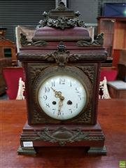 Sale 8559 - Lot 1047 - Late 19th Century French Eclectic Style Mahogany Mantle Clock, with elaborate brass mounts, the white enamel dial with traces of ret...