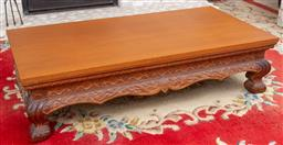 Sale 9164H - Lot 51 - A heavily carved teak coffee table on claw feet, Height 39cm x Width 149cm x Depth 74cm