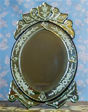 Sale 8577 - Lot 16 - A Venetian style vanity mirror with timber backing and stand, H 57 x W 31cm, Note: yellowing on mirror is light reflection not stain...