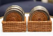 Sale 8709 - Lot 1029 - A set of twelve silver plated and raffia coasters in trays