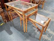 Sale 8745 - Lot 1018 - Nest of Three Cane Side Tables with Glass Top