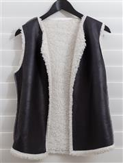 Sale 8902H - Lot 165 - A black leatherette open vest with faux sheepskin lining, size S-M