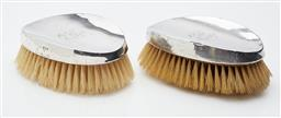 Sale 9085S - Lot 38 - A matching pair of George V Sterling Silver brushes, hallmarked Chester, each width 15cm