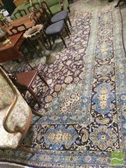 Sale 8428 - Lot 1036 - Large Kashan Wool Carpet, with floral arabesques on a dark blue field (352 x approx. 500cm)