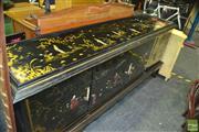 Sale 8386 - Lot 1013 - Oriental 4 Door Sideboard with Figural Decoration (front leg damaged)