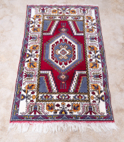 Sale 8795A - Lot 44 - A small woollen, hand knotted Turkish carpet, 152 x 88cm
