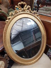 Sale 8831 - Lot 1057 - Continental Gilt Framed Oval Mirror