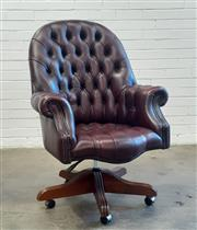 Sale 9085 - Lot 1019 - Buttoned Burgundy Leather Office Armchair, with stud work & on swivel base (h:111 x w:80 x d:60cm)