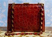 Sale 8577 - Lot 21 - A stylish vintage 1950s original Crocodile leather handbag featuring beautiful deep reddish brown Crocodile leather, large lucite &...
