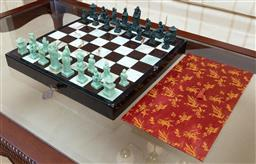 Sale 9155H - Lot 35 - A folding cased Chinese chess set with soapstone pieces. Board size 48x48cm
