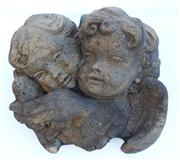 Sale 8362A - Lot 31 - A cast stone wall plaque of two cherubs, size 27 x 30 cm