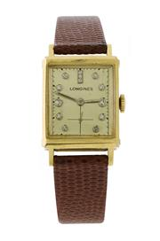 Sale 8522A - Lot 38 - A fine early Longines tank wristwatch in 14 K gold case with diamond dial, 29 x 20 mm, hand winding, in working order.