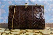 Sale 8577 - Lot 22 - A vintage dark brown snakeskin leather handbag, featuring brown snakeskin front and grey leather back & sides, gold hardware, kiss c...