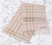 Sale 8902H - Lot 129 - A Burberry cashmere tartan scarf in pink and cream tones together with a white knitted example