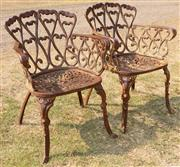 Sale 8871H - Lot 64 - Pair of cast iron chairs. Height 72cm x Width 50cm