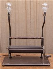 Sale 8984H - Lot 11 - A Wombat Hollow lamp, the base repurposed from a vintage metal paper roll dispenser with bent double metal risers and round bulbs. H...