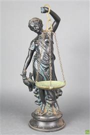 Sale 8608 - Lot 93 - Antique cast metal sculpture of Lady Justice holding a set of scales, height 46cm
