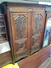 Sale 8774 - Lot 1024 - French Renaissance Style Carved Walnut Armoire, with two multi-panelled doors with masks, strap and foliate work, on cabriole legs....