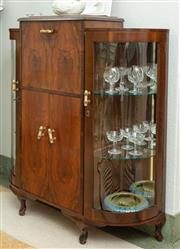 Sale 9066H - Lot 3 - An art deco walnut cocktail cabinet with full front revealing a mirrored interior and glazed curved sides with shelved interior. H 1...