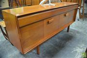 Sale 8326 - Lot 1062 - Teak Three Drawer Sideboard with Concertina Doors