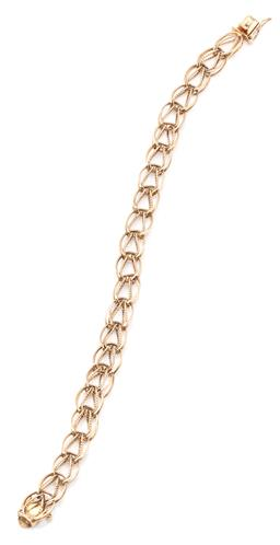 Sale 9145 - Lot 301 - A 10CT GOLD BRACELET; 9mm wide fancy open link chain to box clasp with safety clip, length 19cm, wt. 9.18g.