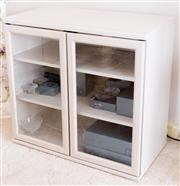 Sale 8369A - Lot 62 - A two door glass fronted limed contemporary bookcase, H 72 x W 76 x D 40cm