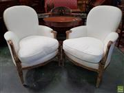 Sale 8598 - Lot 1049 - Pair of Louis XVI Style Painted Beech Bergeres, the finish distressed, fully upholstered in white patterned fabric & on turned flute...