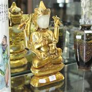 Sale 8336 - Lot 70 - Leaf Gilt Nephrite Multi-Armed Guan Yin