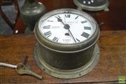 Sale 8359 - Lot 1085 - Large Prescott Clock Co Brass Ships Clock with white enamel dial (Key & Winder in Office)