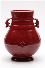 Sale 9060 - Lot 72 - A Chinese Red Glazed Twin Handle Vase, Marked to Base (H 26cm)