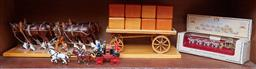 Sale 9103M - Lot 496 - A group of three horse carriage figural groups including two Matchbox models of yesteryear, and a large timber example, Length 60cm