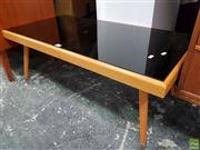 Sale 8566 - Lot 1046 - Vintage Coffee Table with Black Glass Top