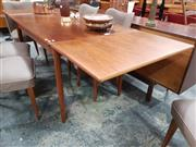 Sale 8782 - Lot 1079 - Teak Extension Dining Table with Drawer Leaves