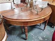 Sale 8868 - Lot 1045 - Unusual 19th Century French Fold Over & Extending Dining Table, the demi-lune top opening to a circle and with telescopic action