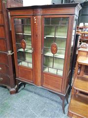 Sale 8917 - Lot 1002 - Edwardian Inlaid Mahogany Display Cabinet, with two astragal doos & central bowed section, lined in green fabric & on tapering legs...