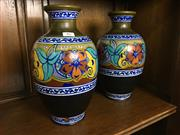 Sale 8730B - Lot 86 - Pair of Dutch Gouda Ceramic Urns Depicting Flowers (Hairline to lip on one) H: 29cm