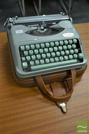 Sale 8528 - Lot 1004 - Pale Blue Hermes Baby Typewriter