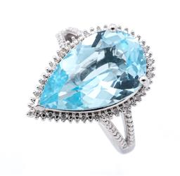 Sale 9246J - Lot 316 - AN SILVER TOPAZ QUARTZ AND DIAMOND COCKTAIL RING; featuring a pear cut blue topaz of approx. 9.37ct to surround of single cut diamon...