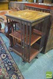Sale 8390 - Lot 1036 - A Good Edwardian Inlaid Mahogany Revolving Bookcase with a round medallion and two tiers.
