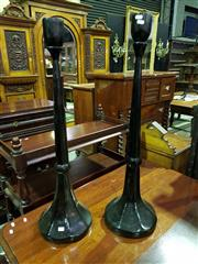 Sale 8653 - Lot 1004 - Pair of Possibly Japanese Tall Ebonised Candlesticks, of inverted trumpet form with slightly faceted sides