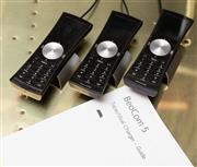 Sale 8709 - Lot 1036 - Three Bang & Olufsen Beocom landline handsets and docking stations