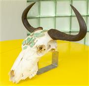 Sale 9066H - Lot 7 - A cow skull with a decorative agate slice motif on a wall mountable bracket. H 48cm.