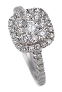 Sale 9123J - Lot 70 - A 10CT WHITE GOLD DIAMOND CLUSTER RING; cushion shape cluster centring 9 round brilliant cut diamonds to surround and upswept should...