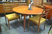 Sale 8338 - Lot 1033 - Round Teak Extension Dining Table & Four Ladderback Chairs