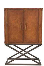 Sale 8620A - Lot 31 - A luggage inspired cocktail cabinet, exterior shell upholstered in hand aged leather, lined in light grey suede, with muted X frame ...